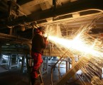 UK factory PMI surges to 16-month high, exports recover